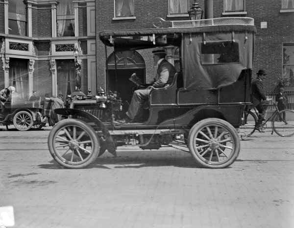 Hooded car outside the Shelbourne Hotel, St. Stephen's Green. Car is possibly a 12 hp Panhard and it is fitted with a Brougham body with an...