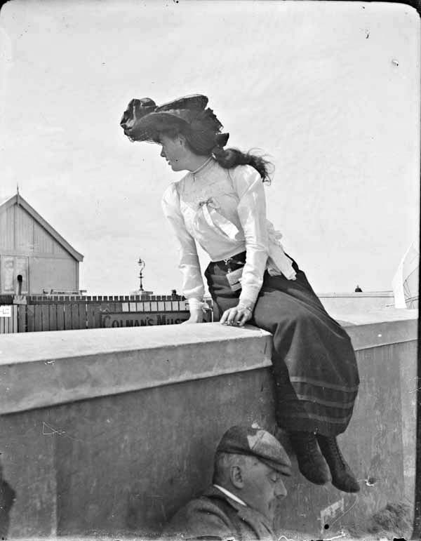 Woman sitting on a wall