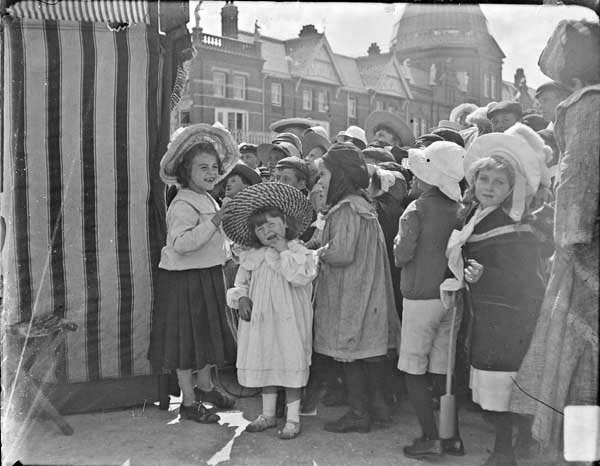 "Group of children watching a """"Punch and Judy"""" show"