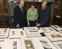 Mr Brian Lalor showing some of the 79 prints and 26 drawings which he donated to the NLI in 2005.
